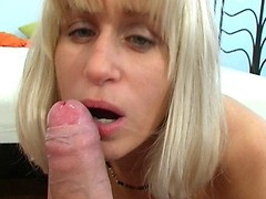After passionate blowjob MILF receives nice load of sperm