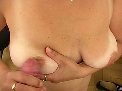 Old slut with shaggy tits plays with younger erected cock