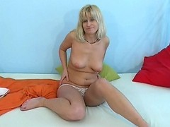 Cute naked MILF undresses slowly and sucks knob