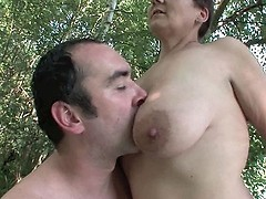 Mature woman gives lick her big boobs