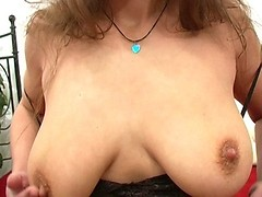 Big natural boob of hot mom in sexy black corset