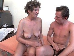 Horny granny sucking her grandsons dick while playing with her pussy