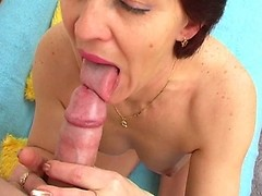 Sexy milf sucking off and licking a huge cock masterfully