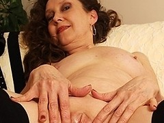 Horny mature slut fingering on the couch