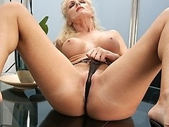 Horny MILF masturbating on her glass table