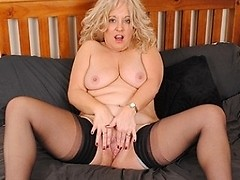 Blonde mature slut getting wet on her couch