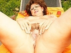 Mature momma enjoys the pool and her hairy beaver
