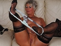 Classy MILF working out her pussy
