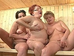 Sexy older lesbian caress each other in sauna