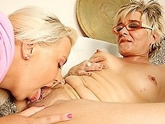 Hot blonde babe munching on a mature lesbian pussy