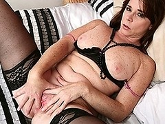 Hot housewife playing with her pussy