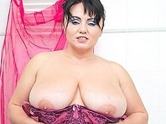 Big breasted MILF getting wet in the shower