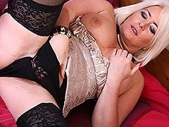 British MILF playing with her shaved pussy
