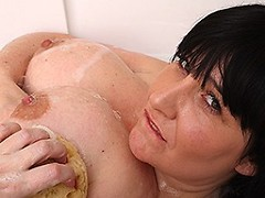 Huge breasted mature lady having sex with herself