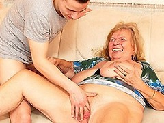 Big breasted mama playing with her toy boy
