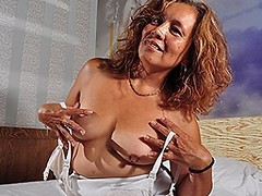 Horny mature latin lady masturbating