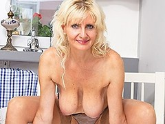 Hot blonde housewife playing with her wet pussy
