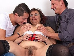 Hairy mature lady fucking in a steamy threesome
