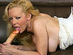 naughty blonde housewife playing with her toy
