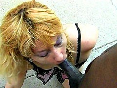 Horny milf stuffs her mouth with black cock