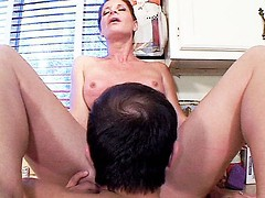 Stunning granny Linda Roberts satisfies herself by riding a huge cock on the kitchen floor