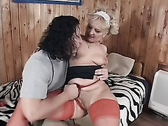 Stocking clad blonde granny Ursula got herself a fuck buddy and gives him an unforgettable blowjob