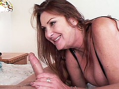 Older bombshell Gigi blows a massive cock making it hard and ready for fucking