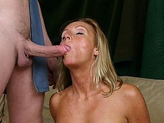 Mature granny Gigi gets showered with jizz after alternately sucking on two dicks