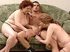 Plump redhead granny sharing a huge cock with a mature blonde bitch