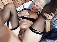 Naughty grandma Erin gets dirty with her fuck buddy and later welcomes his cock in her old cooter