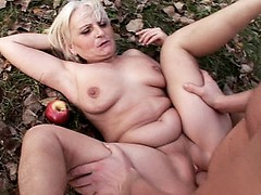 Blonde grandma Mandy enjoys the sun as she gets her pussy fucked hard