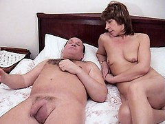 Horny granny Eva lays on her side while she gets an awesome spoon style shagging