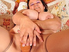 Big breasted Latin mama playing with her toy