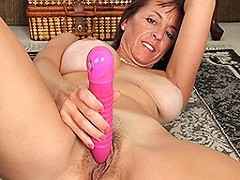 Naughty American mom playing with her toy