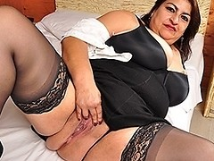 Latin mature BBW playing with her big tits