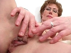 Aroused granny plays with her pussy lips and clit