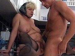 Naughty housewife fucking in the kitchen