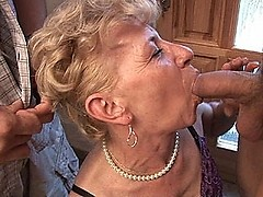 Granny rides a cock buried deep inside her